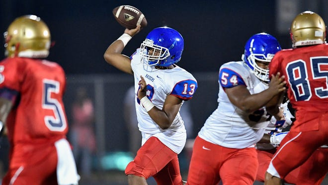 McGavock High quarterback Ty Kirk (13) passes against Whites Creek High during the Metro jamboree game at Whites Creek High School Aug. 10, 2017.