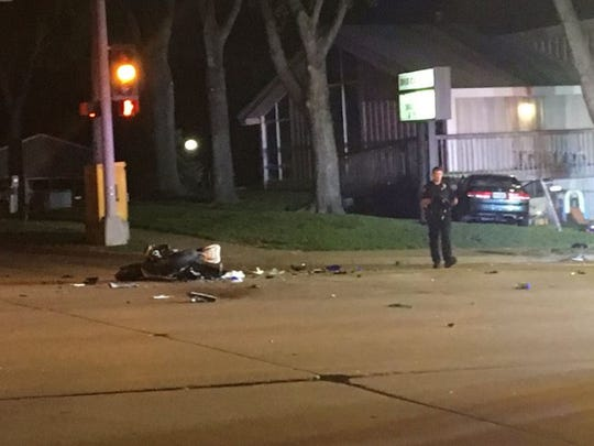 Police respond to a car-motorcycle crash on W. 41st