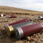 Shotgun shells lie on the ground at the Baker Draw Designated Shooting area in Pawnee National Grasslands in this February file photo.