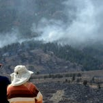 People on the east side of Horsetooth Reservoir watch the Galena Fire as it burns west of Fort Collins in this March 16, 2013, photo.
