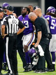 Minnesota Vikings running back Dalvin Cook (33) is helped off the field after being injured during the second half of an NFL football game against the Detroit Lions, Sunday, Oct. 1, in Minneapolis.