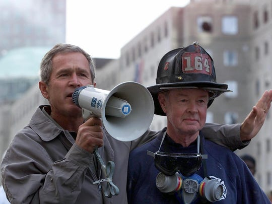 President George W. Bush addressing volunteers and