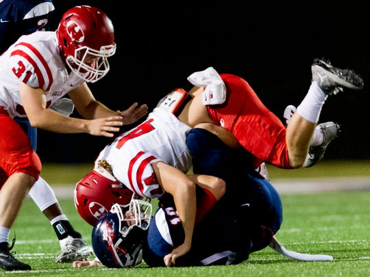 South Doyle's Mason Brang (10) is tackled by Halls' Hunter Woods (44) during a game between South Doyle and Halls at South Doyle High School in Knoxville, Tennessee, on Friday, October 6, 2017.