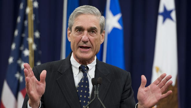Robert Mueller speaks during a farewell ceremony in his honor at the Department of Justice on Aug. 1, 2013.