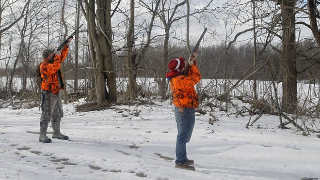 Richard Jr., left, and his brother Tim take aim in the trees Saturday during the Holley Fire Department's 2013 Squirrel Slam.