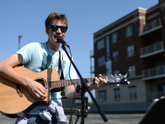 "At 16, Jackson Mankowski of De Pere has kept up a busy summer of gigs, including farmers markets in Green Bay and Appleton. His dad, musician Woody Mankowski, is often his ""ad hoc roadie."""