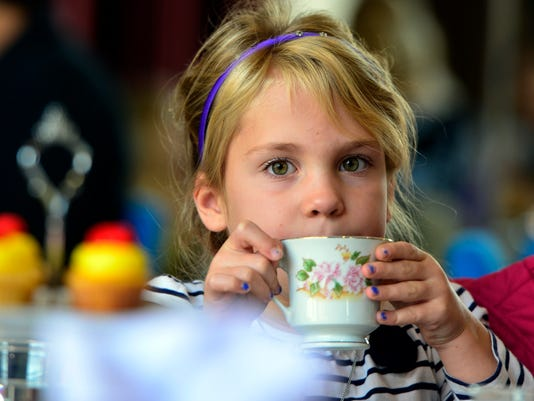 Finley Radebaugh, 6 of Freeland MD, drinks her tea during a  party before the Disney's Beauty and the Beast show at the Strand, Sunday Nov. 1, 2015. Members of the cast and production crew visited the party and held a costume contest before the sold out performances. John A. Pavoncello - jpavoncello@yorkdispatch.com