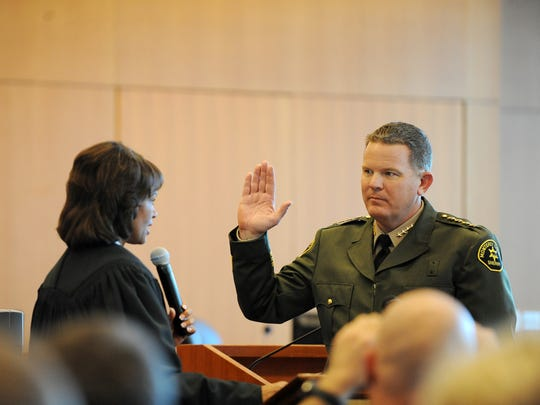 Steve Bernal is sworn in as Monterey County Sheriff-Coroner by Judge Marla Anderson at the Monterey County Government Building on Monday in Salinas.