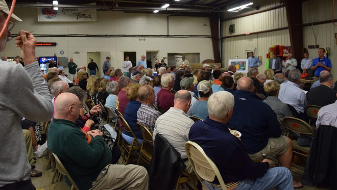 The Millville Volunteer Fire Company was packed with residents concerned about commercial aquaculture.