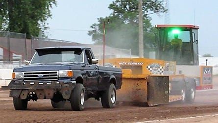 A pickup competes in a Wisconsin Upper Michigan Pullers Association event. WUMPA is holding truck pull at 7 p.m. June 8 at Oconto City Docks.