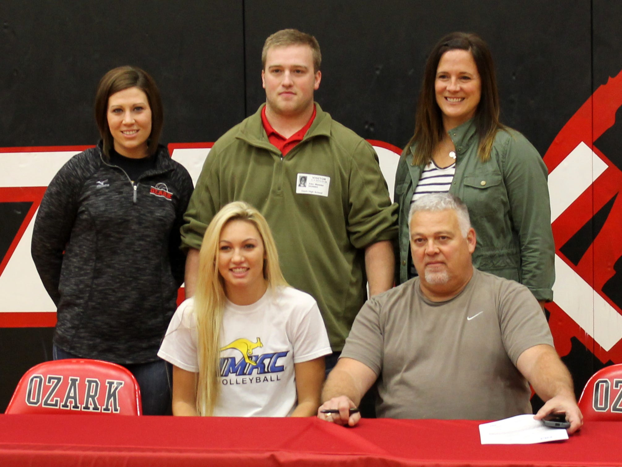 Ozark senior setter Kendra Sater (seated, center) signed to play volleyball at the University of Missouri-Kansas City.