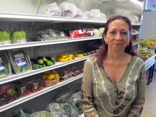 Patricia luzarraga manages the new mother earth natural foods store in