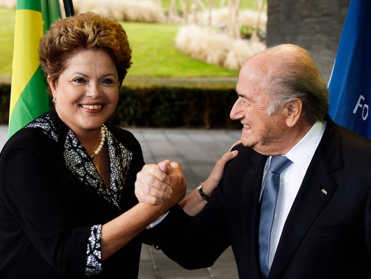 "FIFA President Joseph ""Sepp"" Blatter, right, meets with Dilma Rousseff, President of Brazil, left, prior to talks at the FIFA headquarters in Zurich, on Thursday, Jan. 23, 2014.  (AP Photo/Keystone,Steffen Schmidt)"