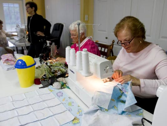 Volunteers' sewing projects touch those in need