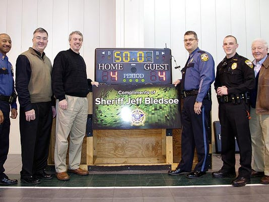Sheriff donates scoreboards.jpg