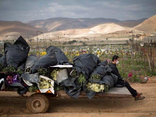 APTOPIX Mideast Israel Boycott Hits Home