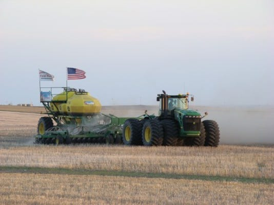 -Tractor in Field.jpg_20130129.jpg