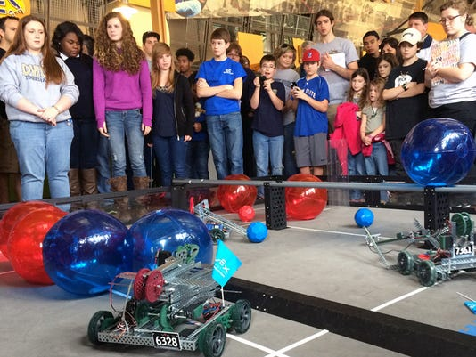 Students observe teams at the Louisiana Tech-Red Stick VEX Tournament.jpg