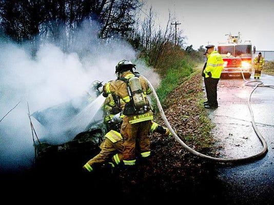 Overturned burning car.jpg