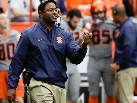 FILE - In this Saturday, Oct. 15, 2016, file photo, Syracuse head coach Dino Babers signals to players during the first half of an NCAA college football game against Virginia Tech, in Syracuse, N.Y. Syracuse is back on track after a big home win, and the fourth game of the Orange's second season under coach Dino Babers is at hand. This is when his system is supposed to be ready for takeoff and Babers is anxious to see if it is.  (AP Photo/Mike Groll, File)