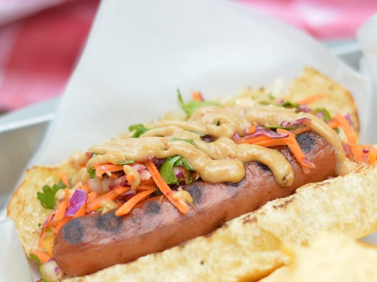 Crunchy slaw, spicy peanut sauce and coarsely chopped peanuts adorn this Asian dog.