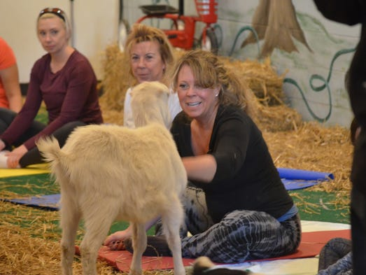 Yoga instructor Tracey Morgado of Vineland pets one