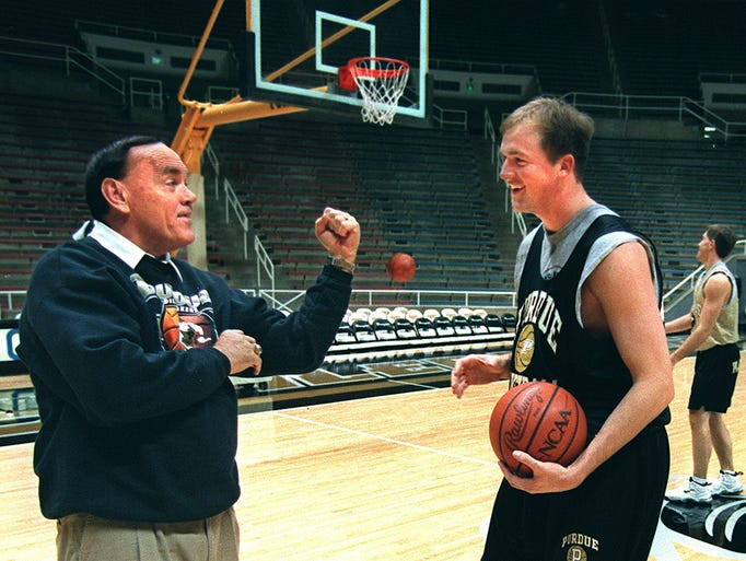 FILE - Gene Keady is ready to go to battle after being egged on by Brian Cardinal during a shoot around the afternoon before the Long Island game.