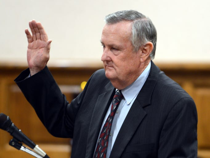 Twenty-Sixth Judicial District Attorney General Jerry Woodall is swron in by Judge Roy B. Morgan, Jr., Friday.