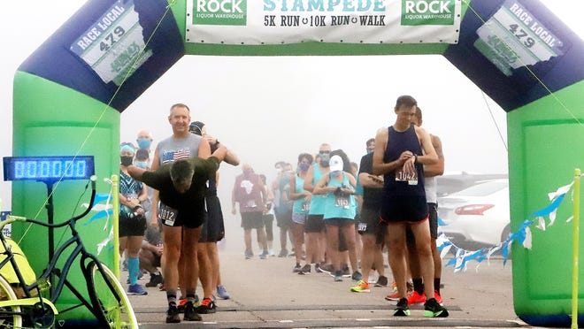 Runners get ready to start the Teal Stampede 5K and 10K Run & Fun Walk, Saturday, Sept. 26, at Chaffee Crossing, benefiting The River Valley Ovarian Cancer Alliance and the Leukemia & Lymphoma Society.