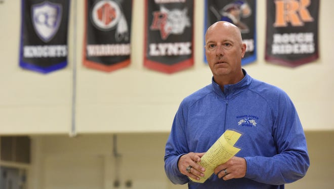 Tim Weidenbach, assistant basketball coach at O'Gorman Catholic High School, speaks to students on Thursday, May 31, 2018.
