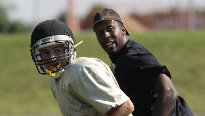 Tarig Holman (right) works with the defensive backs during practice at South Brunswick in this 2009 file photo.