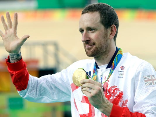 "FILE - This is a Friday, Aug. 12, 2016 file photo of Gold medalist Bradley Wiggins of Britain as he poses on the podium of the Men's team pursuit final at the Rio Olympic Velodrome during the 2016 Summer Olympics in Rio de Janeiro, Brazil. Somewhere in Russia, one imagines, computer hackers are congratulating themselves on a well-executed con. By stealing and then publishing the private medical files of more than 100 international athletes from a World Anti-Doping Agency database, the self-described ""Fancy Bears hack team"" diverted attention from Russia's systemic abuse of banned performance-enhancing drugs in sport, the biggest doping scandal since East German officials fed powerful steroids to teenagers during the Cold War. (AP Photo/Pavel Golovkin, file)"
