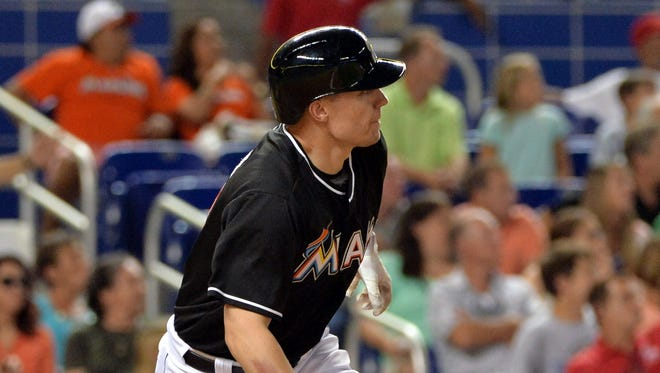Miami Marlins batter Jeff Baker (10) connects for the game winning an RBI single in the ninth inning against the Washington Nationals at Marlins Ballpark.