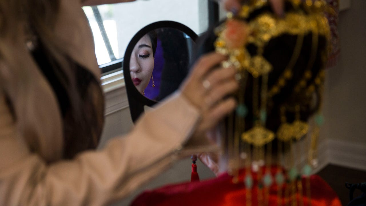 Sherry Gray and Ryan Gray hold a traditional Chinese wedding ceremony in Naples on Saturday, Feb. 17, 2018.