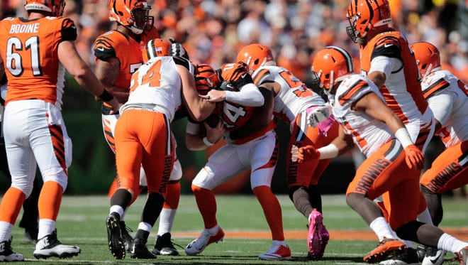 Cincinnati Bengals quarterback Andy Dalton (14) is pressured in the first quarter during the NFL Week 7 football game between the Cleveland Browns and the Cincinnati Bengals, Sunday, Oct. 23, 2016, at Paul Brown Stadium in Cincinnati. Cincinnati won 31-17.