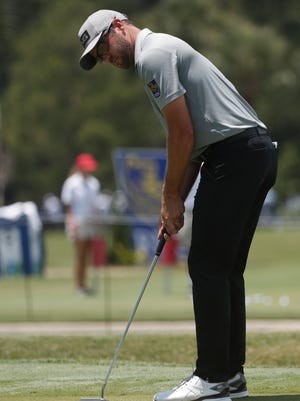 Corey Conners of Canada putts on the ninth green, during the second round of the RBC Heritage golf tournament, Friday, June 19, 2020, in Hilton Head Island, S.C.