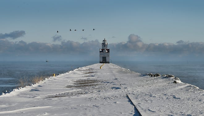 Steam rises over Lake Michigan after the warmer water meets the frigid cold temperatures Sunday in Kewaunee. The lighthouses in Kewaunee and Algoma would have their lenses replaced with more energy-efficient ones under a proposal from the Coast Guard Great Lakes.