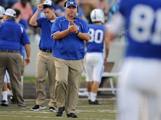 Memorial head coach John Hurley claps during Friday's