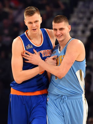 New York Knick forward Kristaps Porzingis (6) and Denver Nuggets center Nikola Jokic (15) react in the skills challenge during NBA All-Star Saturday Night. Jokic has the potential to be the next Dirk Nowitski, columnist Mark Knudson says.