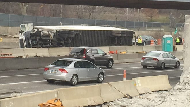 A semi is lying on its side on I-75 at the I-74 interchange.