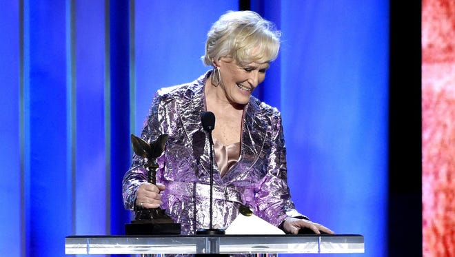 """Glenn Close, winner of the award for best female lead for """"The Wife,"""" reacts as her dog, Sir Pippin of Beanfield, rolls onstage at the 34th Film Independent Spirit Awards on Saturday, Feb. 23, 2019."""
