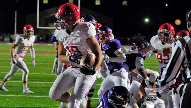Brentwood Academy's Jack McDonald celebrates his touchdown against Father Ryan in the first half  on Friday.