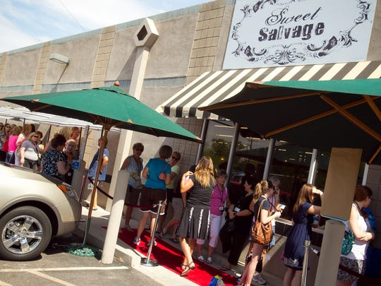 A line forms outside before the opening of Sweet Salvage in Phoenix on Thursday, July 19, 2012.