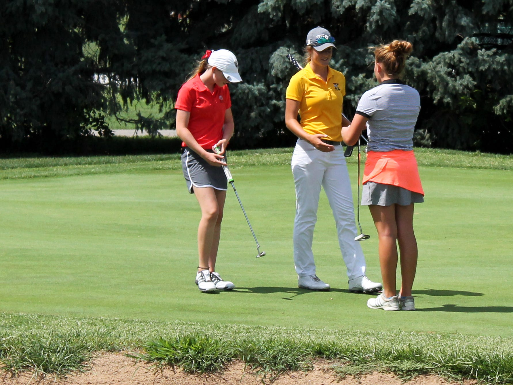From left: all-state girls golf players Wriley Hiebert of Glendale, Ari Acuff of Kickapoo and two-time state tournament qualifier Katie Hamilton of Republic at the conclusion of a 2016 tournament round.