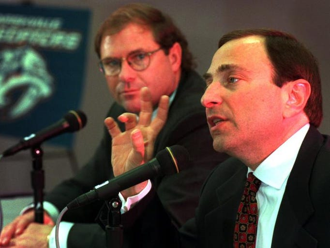 NHL commissioner Gary Bettman, right, talks with the media as Nashville Predators owner Craig Leipold listens March 20, 1998. Tickets sales are closer to the required sales as the deadline draws near.