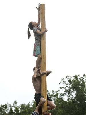 Macie Denton, 12, of Walhalla climbed four men to reach the $200 prize at the top of the greased pole during the 58th Hillbilly Day in Mountain Rest on Tuesday.