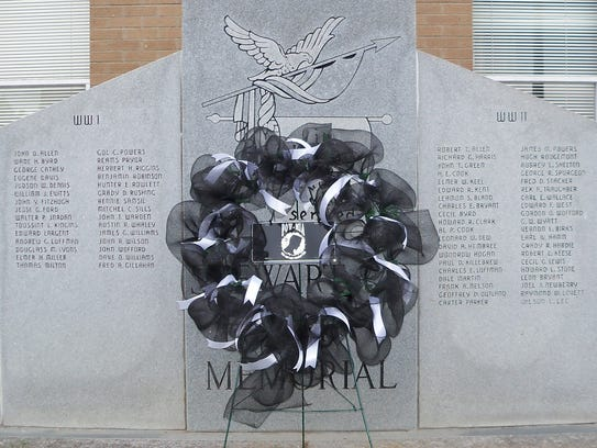 The POW/MIA wreath stands as a silent sentry in front