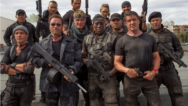 """Staggered from left to right: Jet Li, Antonio Banderas, Glen Powell, Arnold Schwarzenegger, Kellan Lutz, Dolph Lundgren, Wesley Snipes, Ronda Rousey, Randy Couture, Victor Ortiz, Sylvester Stallone, Jason Statham on the set of the motion picture """"The Expendables 3.""""  CREDIT: Composite photo by Phil Bray, Lionsgate [Via MerlinFTP Drop]"""