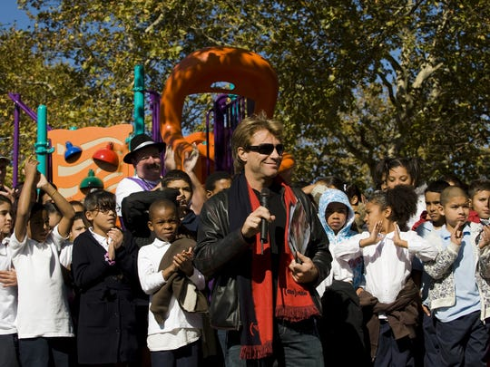Jon Bon Jovi addresses students, teachers and community members at the Rafael Cordero Molina School in Camden on October 19, 2009 for the grand opening of the school's new playground, which was partly funded by the Jon Bon Jovi Foundation.