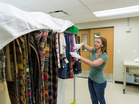 Megan Osborne, coordinator of the Avenir Museum of Design and Merchandising, unpacks and prepares to move in to the new addition of the Avenir Museum of Design and Merchandising in June. The museum opens back up to the public this year.